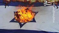 فیلم/ آتشزدن پرچم اسرائیل توسط یهودیان ضدصهیونیست