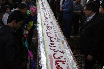 طولانیترین کیک انقلاب اسلامی در گالیکش رونمایی شد + تصاویر